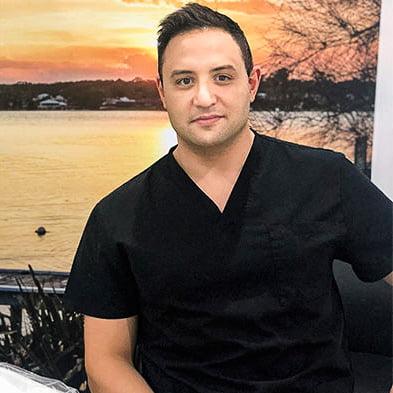 Dr Ned Restom